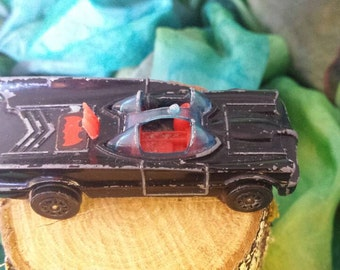 Vintage Corgi Junior Batmobile. Very much preloved but still intact apart from missing Batman and Robin.