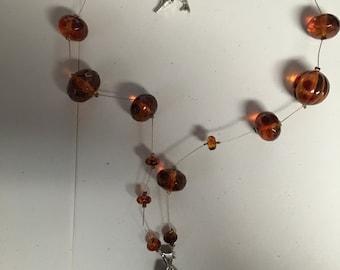 amber beads W/ amminite