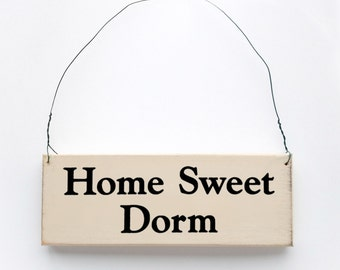 Wood Sign Saying ' Home Sweet Dorm ' White Wood Sign With Black Lettering.