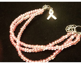 Pink bracelets, breast cancer bracelets, pink beaded bracelets, think pink, cancer jewelry, breast cancer awareness, causes jewelry