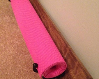 Wall-mount yoga mat holder