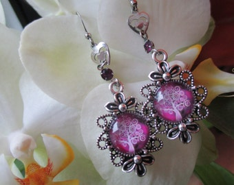 BUCKLES of ears silver tree of life on background pink