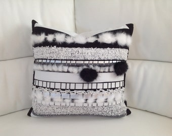 Decorative cushion in leather and fur
