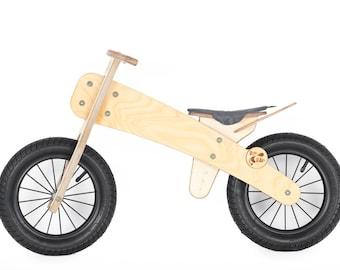Balance bike. Wooden runbike no pedals bicycle trainer. Laufrad aus Holz.