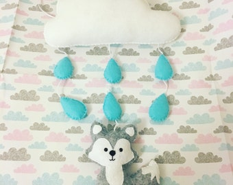 Grey fox underneath a rain cloud wall hanging mobile with blue raindrops
