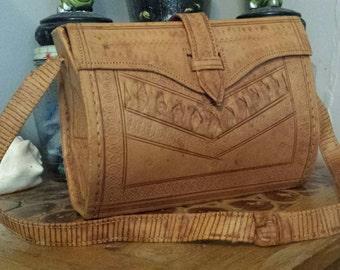 Vintage tooled leather barrel purse
