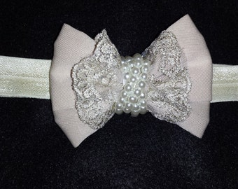 Beige and cream bow