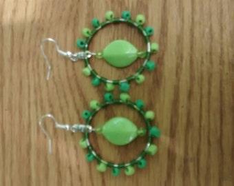 Green dangling beaded earrings