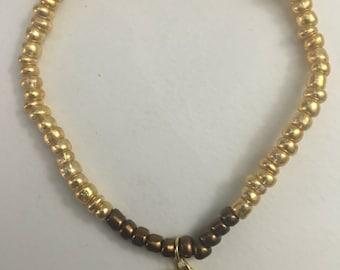 Gold and broze bead bracelet
