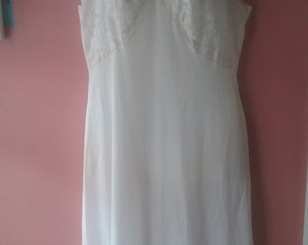 1950's off-white slip with beautiful lace trim.