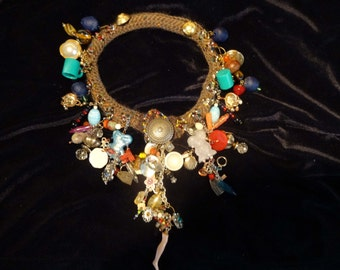 Unusual charm cluster necklace with crochet band, front button closure
