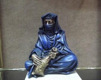 Figure Tuareg woman sitting in resin