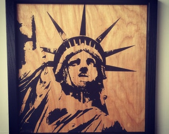 Silk screened picture of the statue of liberty. Framed
