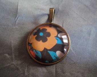 Pendant with print and orange and blue glass cabochon-flowers