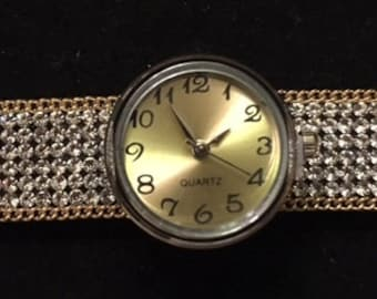 Trendy Sparkling Interchangeable Snap Bracelet with a New Snap Watch.  Great with any outfit.  Good Quality!