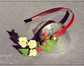 Headband with berries and flowers of strawberry.