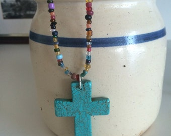 Multi colored beads with turquoise cross
