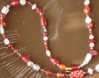 Red Boho necklace that morphs into a bracelet with ease. Wear it either way.