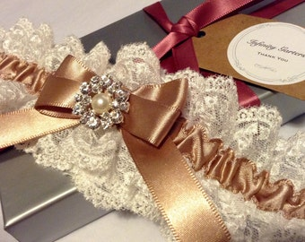 Ivory scalloped edge lace garter with caramel ribbon and faux pearl button with diamonte