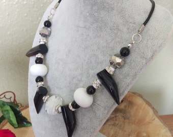 A statement agate tooth necklace