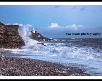 Blue skies and rough seas at Mumbles Lighthouse