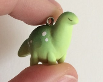 Little green dinosaur charm - kawaii polymer clay figure - Plumpkin brontosaurus dino with freckles
