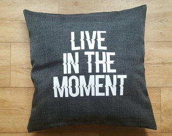 "Dark grey throw pillow. ""Live in the moment"". Also check houseofaudacious.com for more items."