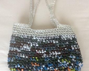 Multi coloured hand crocheted Plarn bag made from recycled plastic