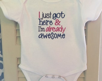 I just got here & I'm already awesome onesie