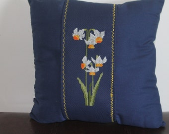 Navy Blue throw pillow with cross-stitch daffodils.