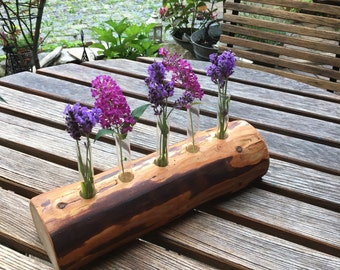 Test tube vase from old solid wood with linseed oil