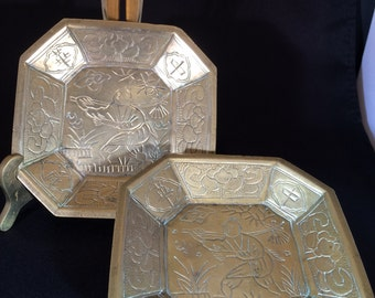 Pair of identical engraved brass dishes that appear to be from the Far East
