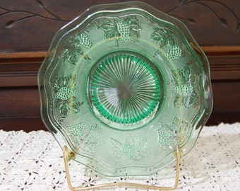 """Stippled Grapes plate; Westmoreland Glass Co; """"Woolworth's""""; Vaseline green; Made in the 1930's; Glows in a black light; Excellent condition"""