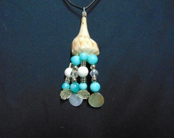 Spiral shell beaded pendant