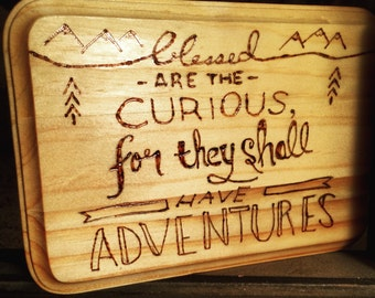 """Burned wood plaque """"Blessed are the curious for they shall have adventures"""""""