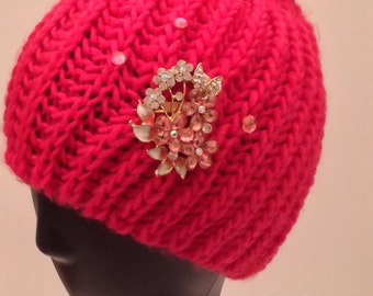Bright pink knit decorated/bedazzled beanie