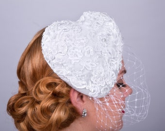 Heart shape bridal fascinator with birdcage veil