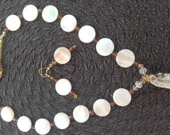 White and gold crystal geode necklace with mother of pearl round disks and matching earings