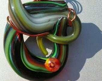 Green swirls in glass