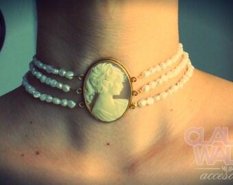 Necklace, cream cameo, river pearls.