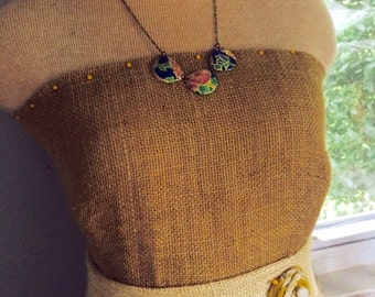 Blue, green, and pink vintage tin necklace