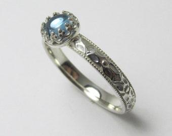 Swiss Blue Topaz bezel set Sterling Silver floral patterned ring 0.66ct Sz 6 1/2
