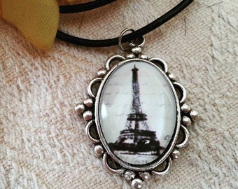 Eiffel tower cabochon pendant on a black cord necklace