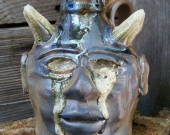 crying eyes whiskey FACE JUG by Joel Patton