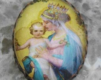 Sweet Madonna glas cabochon set in a vintage bezel 30x40..