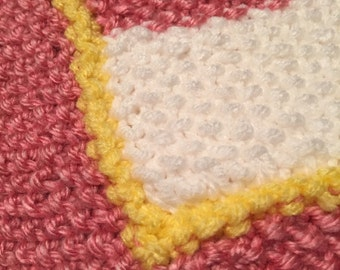 Pink, yellow and white striped knit baby blanket