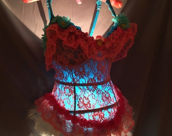 Tramp Lamp Crafted from Blue Bustier top with Pink Lace overylay and assorted Blue Daisies and small pink roses and baby blue feathers