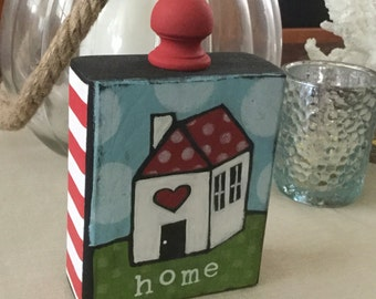 Home - house painted on wood block