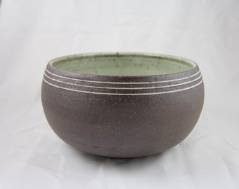 Hand thrown ceramic bowl with mishima detail