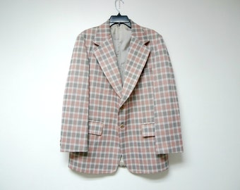 CHILLIN' in PLAID . 1970s jacket . fits a medium to large . made in USA